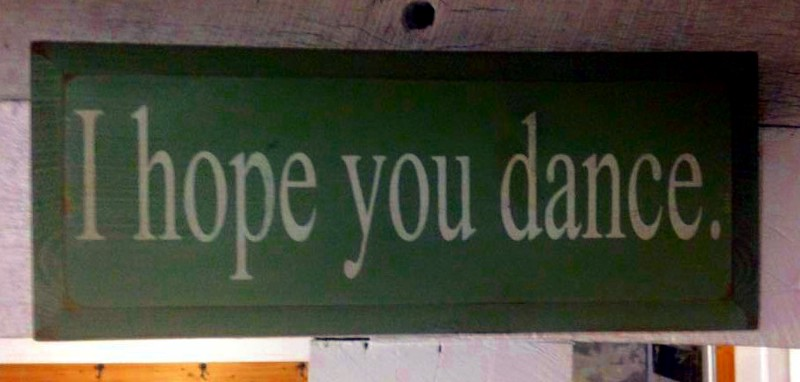 "Wooden sign reading ""I hope you dance"""
